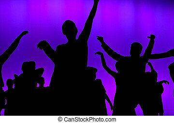 Club concert dancers - Silhouette of young people dancing at...