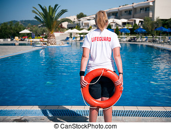 Lifeguard - Female Lifeguard on duty at a swimming pool