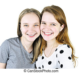 Two teenage girls listening to music - Portrait of two...