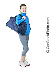 Athletic girl with gym bag ready for workout - Happy fit...
