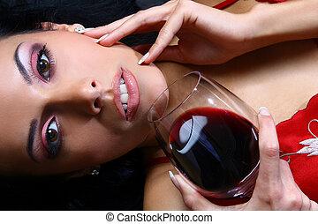 Beautiful woman drinking wine - Beautiful woman drinking...