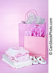 Pink baby shower presents - Gift bags and infant clothes for...