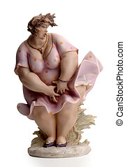 statuette of fat woman - a small statuette of fat woman on...