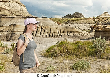 Hiker in badlands of Alberta, Canada - Girl enjoying scenic...