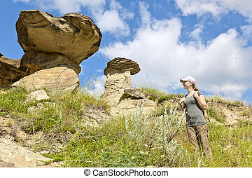 Hiker in badlands of Alberta, Canada - Young girl looking at...