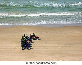 quads at the sea