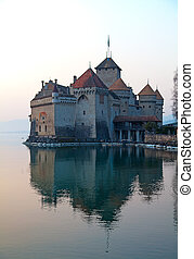 Chillon castle on the Geneva lake at sunset (Montreux,...
