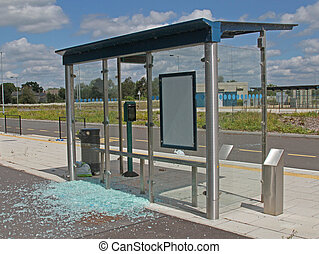 Bus stop vandalised by smashing the glass windows