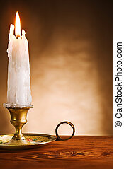 copy space ablaze candle in old candlestick