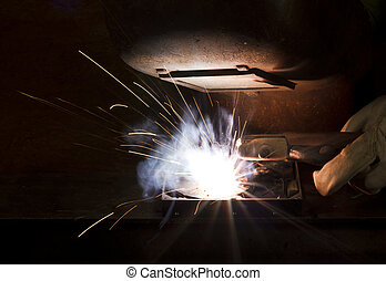welding scenery - symbolic scenery showing the welding of a...