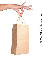 hand holding white paper bag - gesture of hand holding paper...