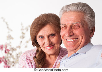 happy elderly couple - nice elderly couple on a white...