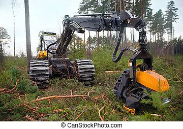 Deforestation - Heavy machine used for deforestation in...