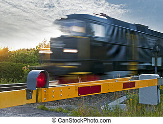 Train at railway crossing - Locomotive passing at a railway...