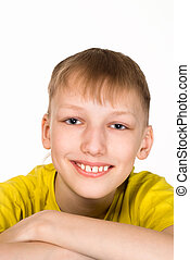 young boy smiling - portrait of a happy young boy on white