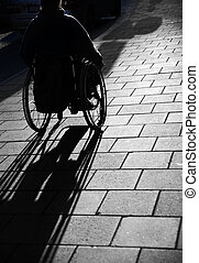 Man in wheelchair - Silhouette of young man in wheelchair