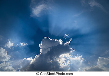 Back lit clouds - Cramatic sky with back lit clouds in blue...