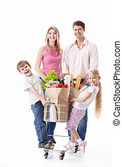 Shopping - A happy family with a cart with food on a white...