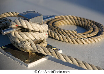 Rope on a boat deck - Rope neatly rolled up on the deck of a...