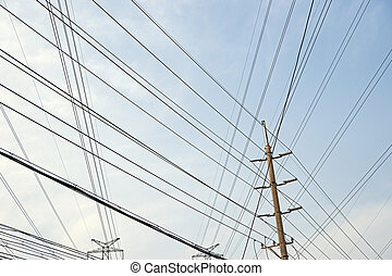 Power lines - Mesh of power lines against blue sky