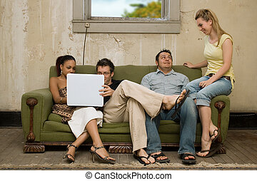 College Friends in Poverty Style Apartment - Group of...
