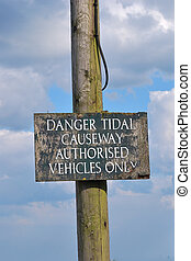 Tidal causeway sign for vehicles only