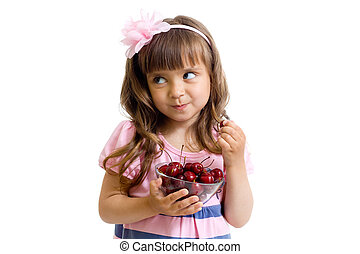 little girl with cherry berries bowl looking to right in...