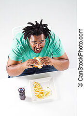 overhead view of african man eating - overhead view of fat...