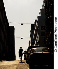 Young man walking towards the future - Silhouette of a young...