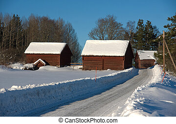 farm buildings covered in snow - Timbered red farm buildings...