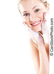 face wash woman - Beautiful caucasian woman washing her face...