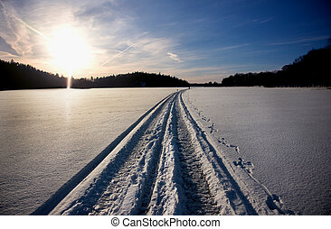 Track from snowmobile in winter landscape