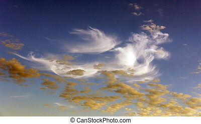 Blue sky with white and yellow clouds
