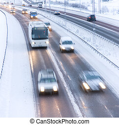 Winter highway - Highway with blurred cars in winter