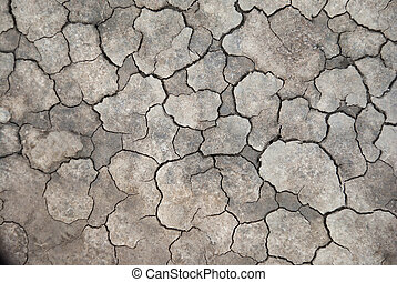 cracked dry clay - Close up of cracked dry clay