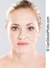 cosmetic surgery - attractive caucasian woman face marked...