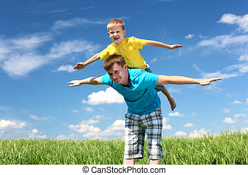 father with son in summer day outdoors - father with little...
