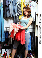 shopper - Beautiful woman looking at her clothes in a...