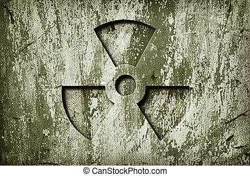 Warning Radiation - A nuclear sign on grunge metal door