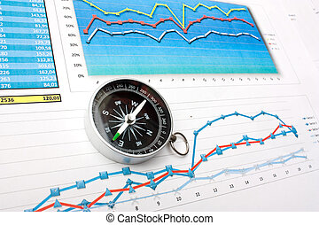 navigation in economics and finance - compass on the...