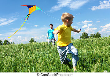 father with son in summer with kite - father with son in...