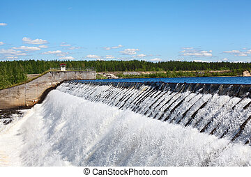 Owerflow of water on dam - Owerflow of water on the man-made...
