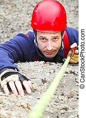 climber with rope - man climber in red helmet with rope