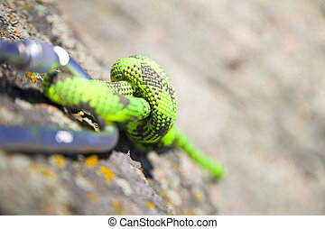 climbers carabiner and loop of green rope