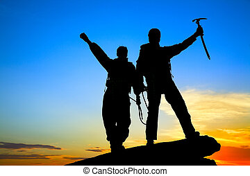 two climbers - Two silhouettes of climbers on the mountain...
