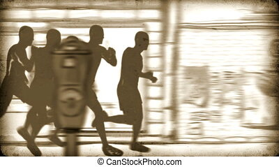 Silhouettes of running people.