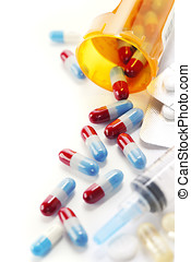 pharmaceutics - Pills spilling out of pill bottle and...