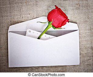 Red Rose and Letter - red rose on old canvas and blank...