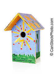 Colorful birdhouse painted by children over white background