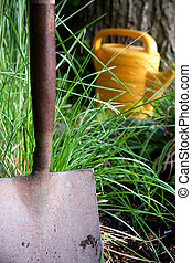 Garden shovel - Close up of garden shovel with wateing can...